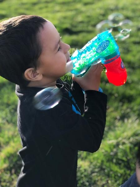 Bubble Gun Blowing Bubbles
